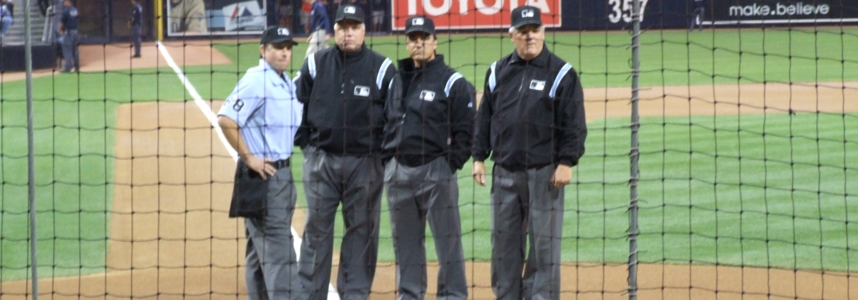 Left to right: Chris Guccione, Brian O'Nora, Phil Cuzzi, and Jerry Crawford