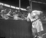 (right), wearing the Hollywood Stars' new shorts and lightweight rayon jerseys, visits with Branch Rickey in 1950 at Gilmore Field.