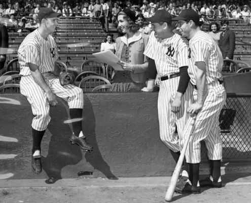 brought her reporter's notebook and cartoonist's sketch pad to Yankee Stadium in 1940. Shown here interviewing Yankee teammates Joe Gordon (left), Lefty Gomez, and Joe DiMaggio (far right).