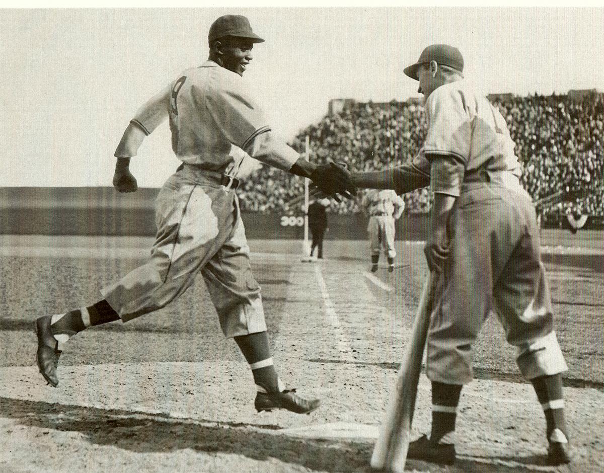 George Shuba greets Jackie Robinson at home plate on April 18, 1946 (Courtesy of Greg Gulas, Carrie Anderson, Mike Shuba)