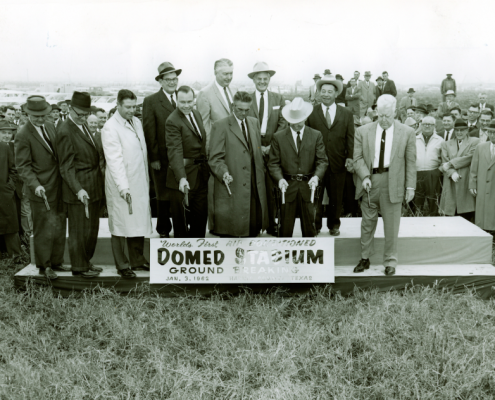 Instead of using shovels, Judge Roy Hofheinz and other officials fire six-shooters at the ceremonial groundbreaking of the Astrodome on January 3, 1962.