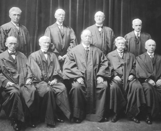 Back row, left to right: Louis D. Brandeis, Mahlon Pitney, James McReynolds, and John H. Clarke. Front row, left to right: William R. Day and Joseph McKenna, Chief Justice William Howard Taft, and Oliver Wendell Holmes and Willis Van Devanter.