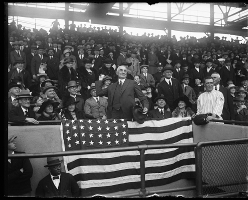 President Warren G. Harding, center, throws out the ceremonial first pitch before a Washington Senators game on April 13, 1921, at Griffith Stadium in Washington, DC. (LIBRARY OF CONGRESS, NATIONAL PHOTO COMPANY)