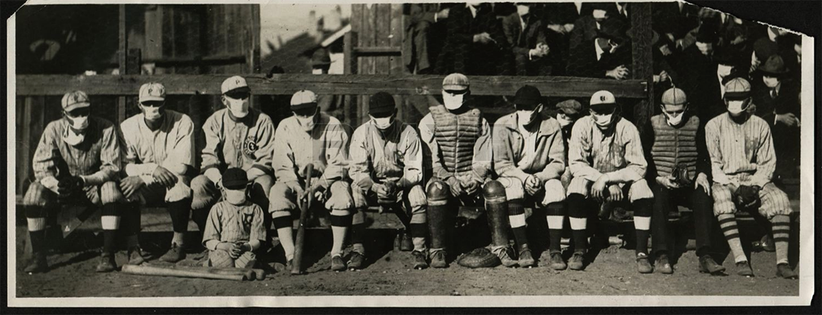 "The Pasadena Merchants winter league team poses for a photo with umpire John ""Beans"" Reardon, second from right, during the ""flu mask"" baseball game on January 26, 1919. Among the players on Pasadena's roster were Emil ""Irish"" Meusel of the Philadelphia Phillies, Fred McMullin and Frank Shellenback of the Chicago White Sox, George Cutshaw of the Pittsburgh Pirates, and Pete Schneider and Red Killefer of the Cincinnati Reds. The players' exact order in this photo is unknown. (RMY Auctions)"