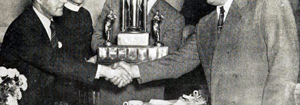 Charlie Culver, right, is honored as manager of the 1950 Montreal junior champions.