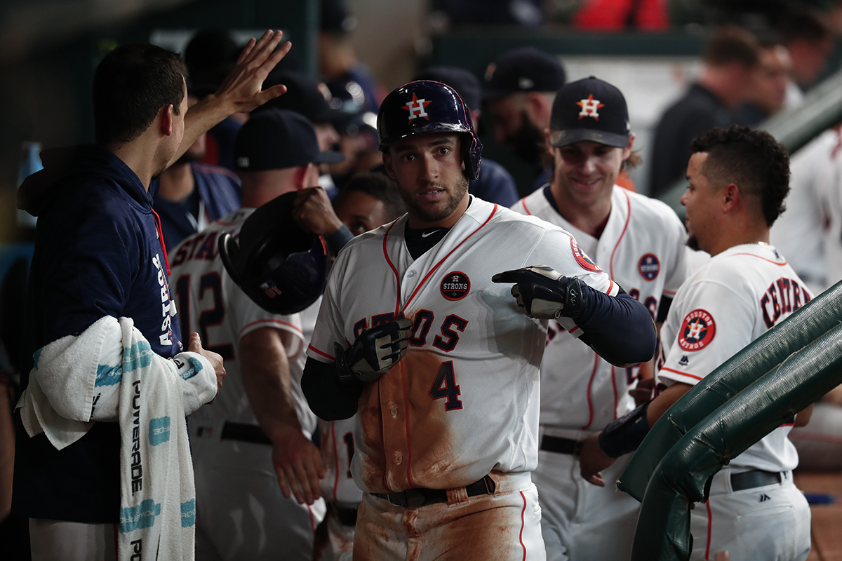 "George Springer of the Houston Astros taps the ""Houston Strong"" logo on his chest after hitting a home run on September 2, 2017, in the team's first game since Hurricane Harvey at Minute Maid Park in Houston.(COURTESY OF THE HOUSTON ASTROS)"