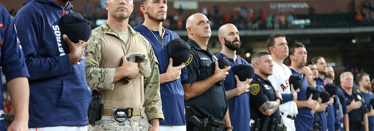 Houston Astros players stand with first responders in the team's first game since Hurricane Harvey on September 2, 2017, at Minute Maid Park in Houston. (COURTESY OF THE HOUSTON ASTROS)
