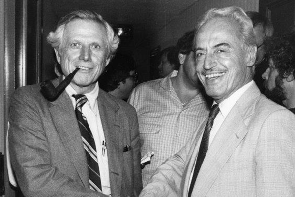 Ray Grebey, left, and Marvin Miller shake hands following the end of the 1981 baseball labor dispute. (NATIONAL BASEBALL HALL OF FAME LIBRARY)