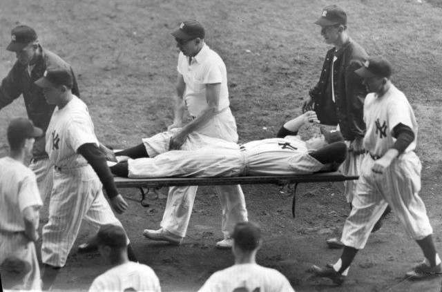 Mickey Mantle is carried off on a stretcher after injuring his knee during the 1951 World Series at Yankee Stadium. (NATIONAL BASEBALL HALL OF FAME LIBRARY)