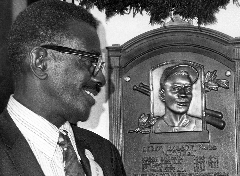 Satchel Paige looks at his plaque during Hall of Fame induction weekend on August 9, 1971, in Cooperstown, New York (NATIONAL BASEBALL HALL OF FAME LIBRARY)