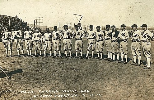 The Chicago White Sox are pictured on April 12, 1918, before an exhibition game against a US Army team at Camp Funston, outside of Junction City, Kansas. Just weeks ear- lier, the first major outbreak of a global influenza pandemic killed 38 soldiers at the base. An estimated 50 million people around the world died from the flu by the time the pandemic subsided in 1920. (BlackBetsy.com)