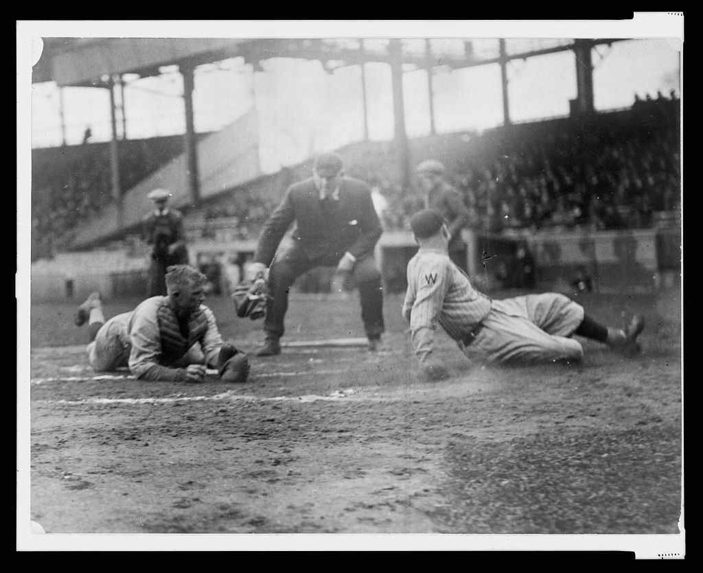 Waiting for the umpire to make the call as Washington ball player, Joe Judge, slides across home plate, the catcher, on the left, is lying on the ground with ball in hand (LIBRARY OF CONGRESS)