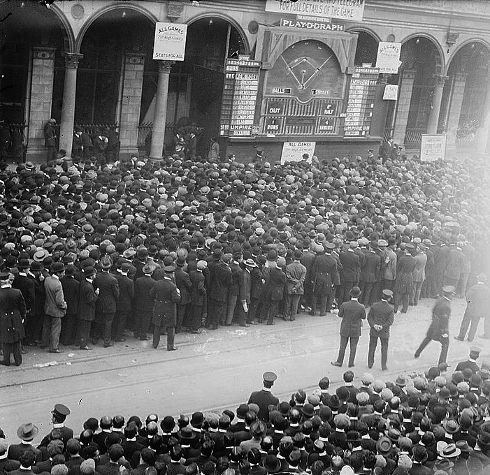 A crowd gathers outside the New York Herald newspaper building to watch a billboard diagram of a game during the 1911 World Series between the Philadelphia A's and New York Giants. (LIBRARY OF CONGRESS)